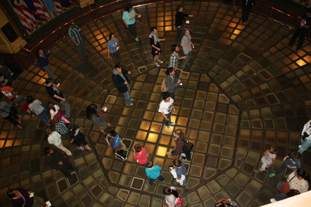 Flash mob in the Michigan Capitol Rotunda.  A line of students on a field trip crossed us as we sang.